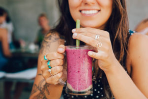 girl drinking healthy smoothie